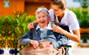 an elderly woman and a caregiver